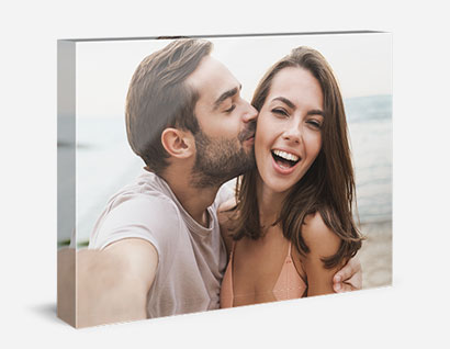 glass block showing photo of man kissing woman