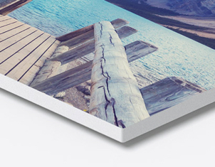 corner of photo board print showing wooden jetty