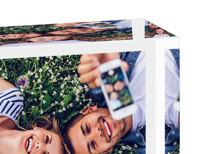 glass block showing photo of man and woman taking selfie