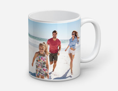 mug printed with photo of man, woman and girl on beach