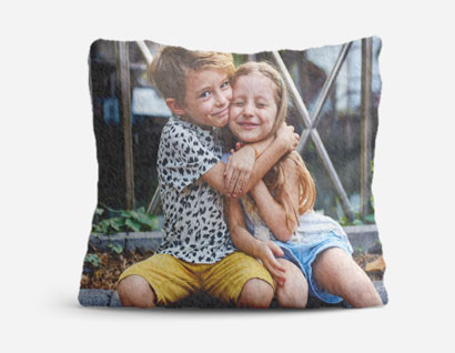 cushion printed with photo of boy and girl embracing