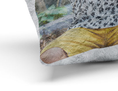 corner of cushion printed with photo of child