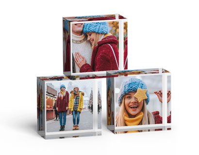 stacked glass blocks showing photos of girl, woman and dog